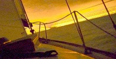 sunset over the boat's bow