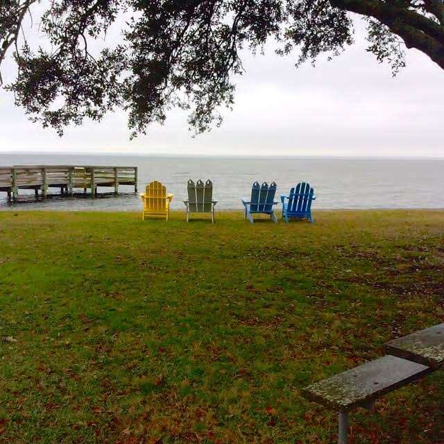 four adirondack chairs facing the atlantic ocean