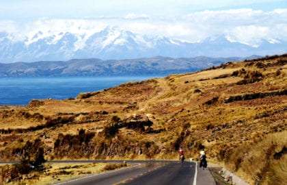 Nancy Sathre-Vogel and her family on bikes, in the Peruvian mountains near Lake Titicaca