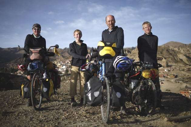 a family standing near bikes in Bolivia