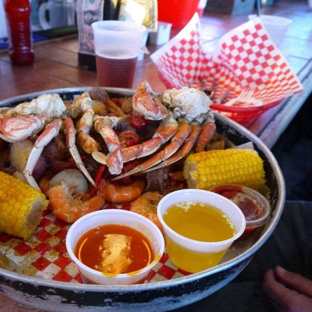 crab legs and corn on the cob at a restaurant