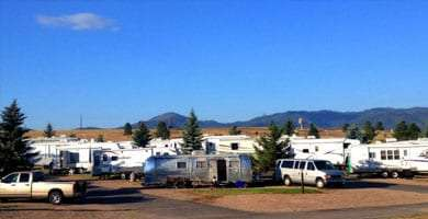 dozens of white box RVs and an Airstream
