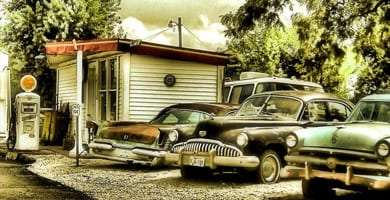 vintage cars live alongside a gas station outside of Yosemite National Park