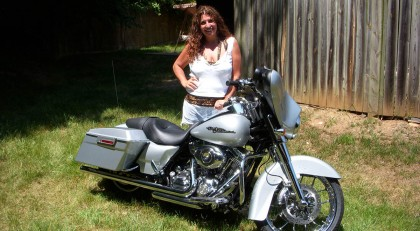 a beautiful middle-aged woman and her harley davidson motorcyle