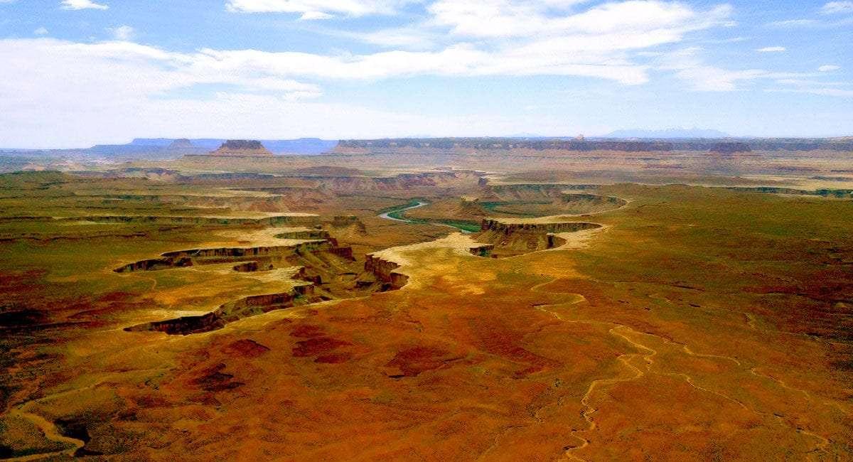 the green river carves deep through desert terrain