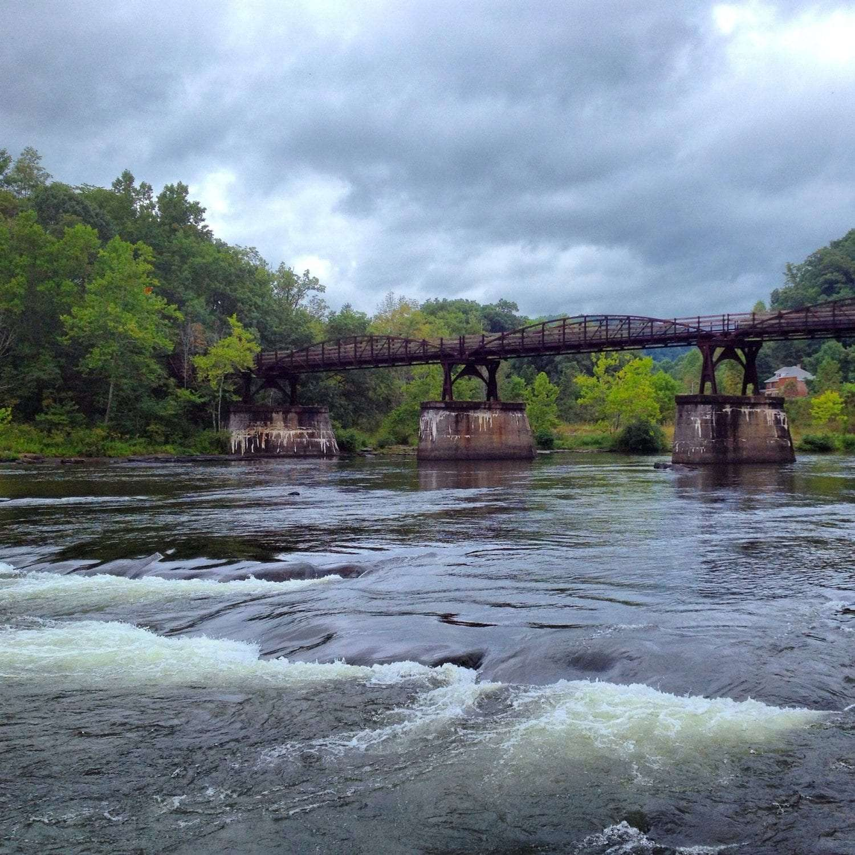 A river flows wide beneath