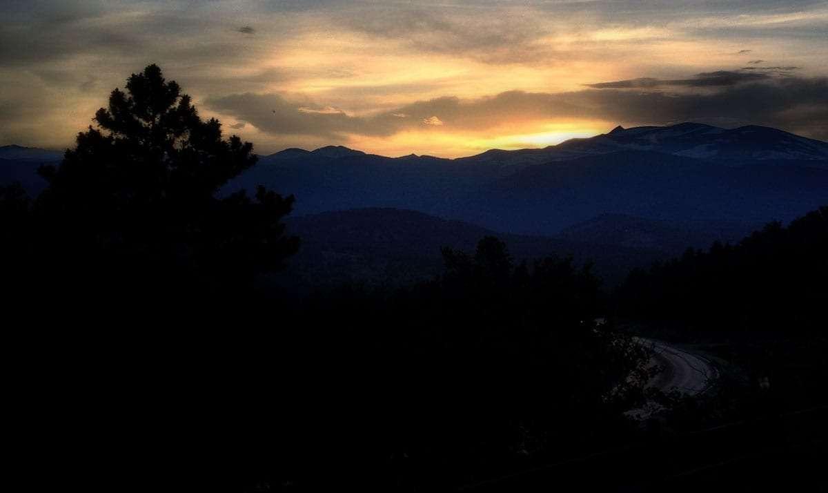 sunset vibrant across mountain peaks
