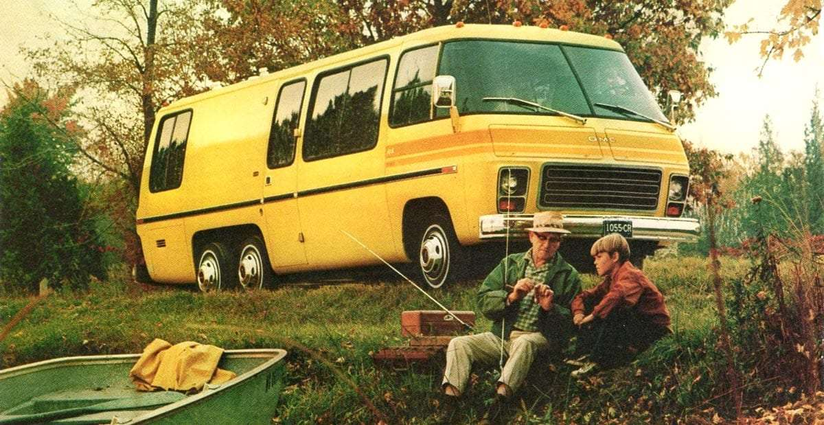 advertisement photo from a magazine showing a bright yellow motorhome, a father and son fish in the foreground