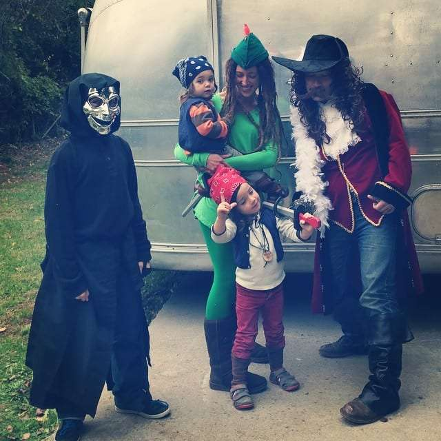 a teenage boy dressed in black robes with a creepy silver mask, a mom dressed as Peter Pan, her boys as small pirates, their dad as Captain Hook.
