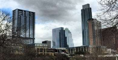 the city of Austin Texas rises above the hill country