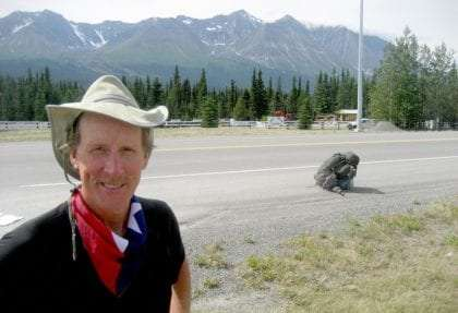 The author, Michael Sean Comerford , and his backpack along a road