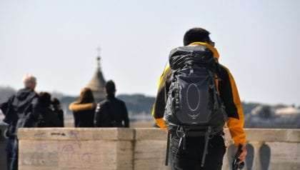 a man backpacking the world
