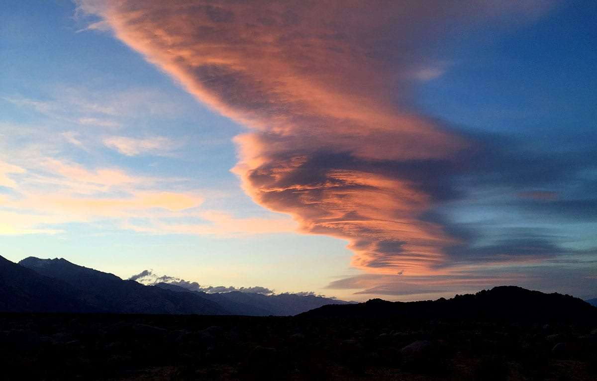 a cloud formation, with raised pockets from the varying pressure systems present here on the leeward side of the Sierra Nevadas, blazing pink brilliance in the evening sky