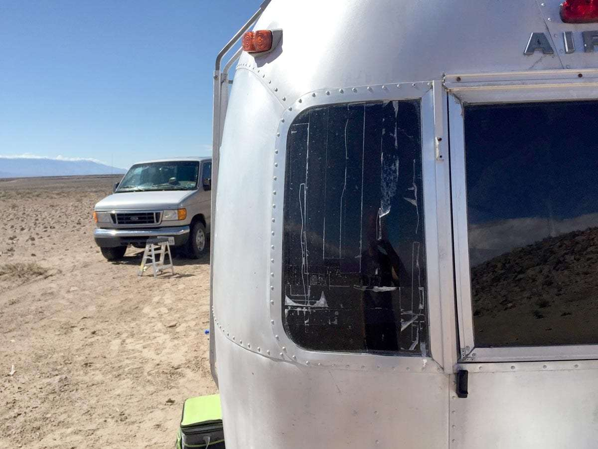 masking tape holding a broken Airstream window together