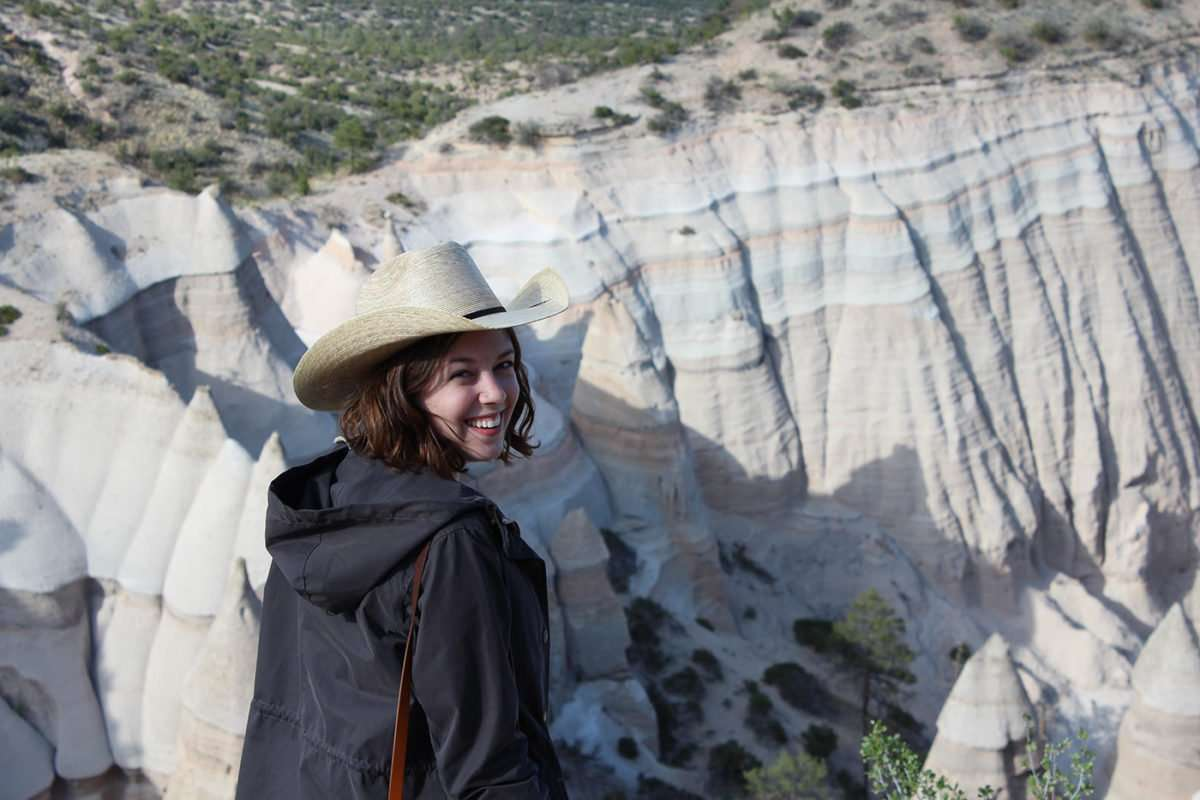 the young Madison Stewart smiling, near what appears to be the Badlands