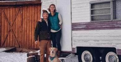 blaize, kathleen and greg outside of their canned ham tiny camper