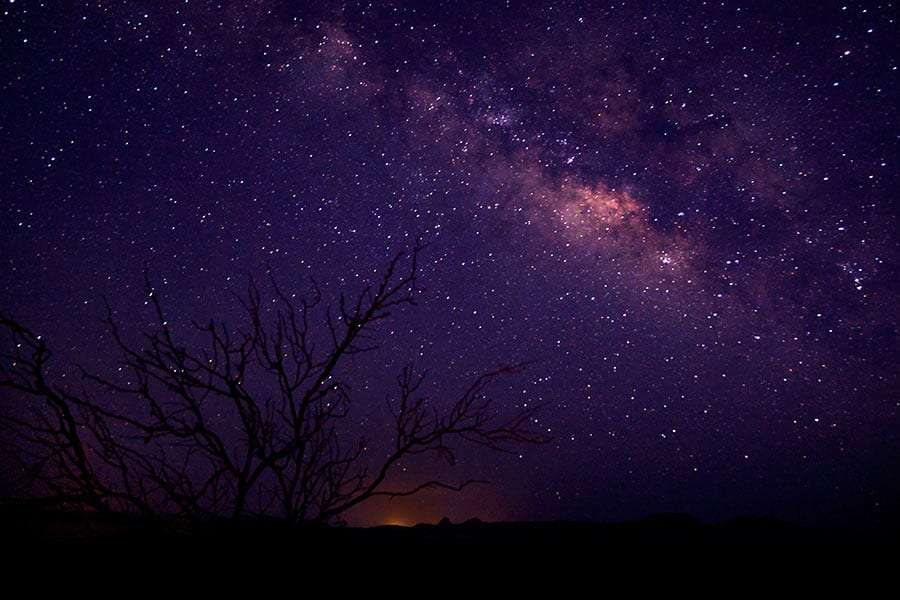 the milky way glows purple in the west texas sky