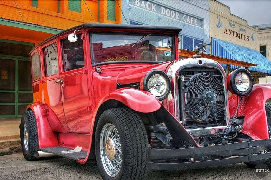 a red hot rod on small main street in Smithville, TX