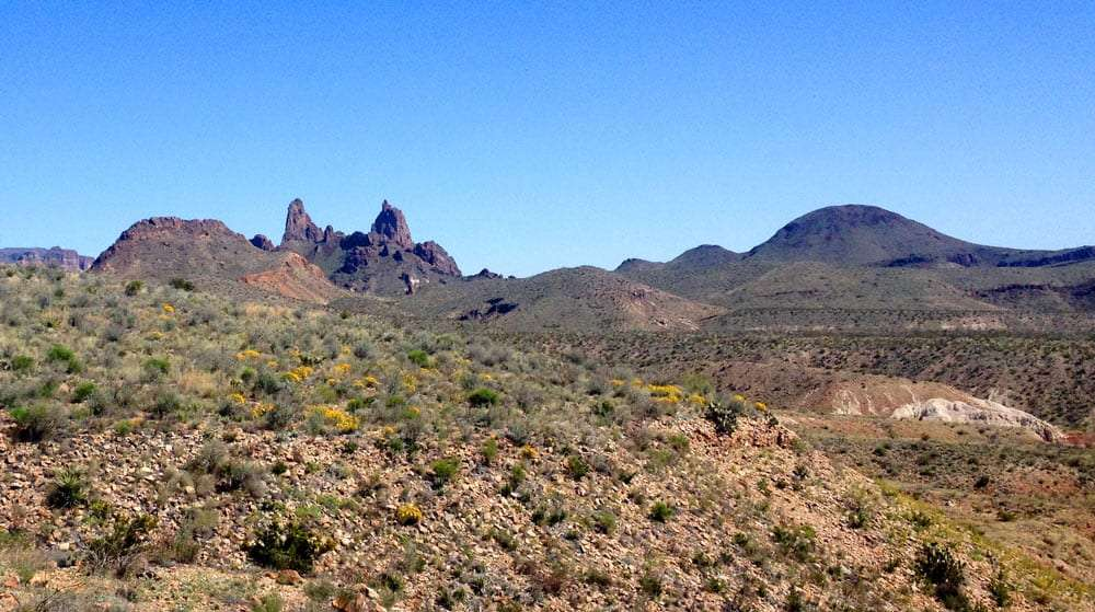 two peaks in the Chisos Mountains which appear to the massive earthen ears of some distant giant mule