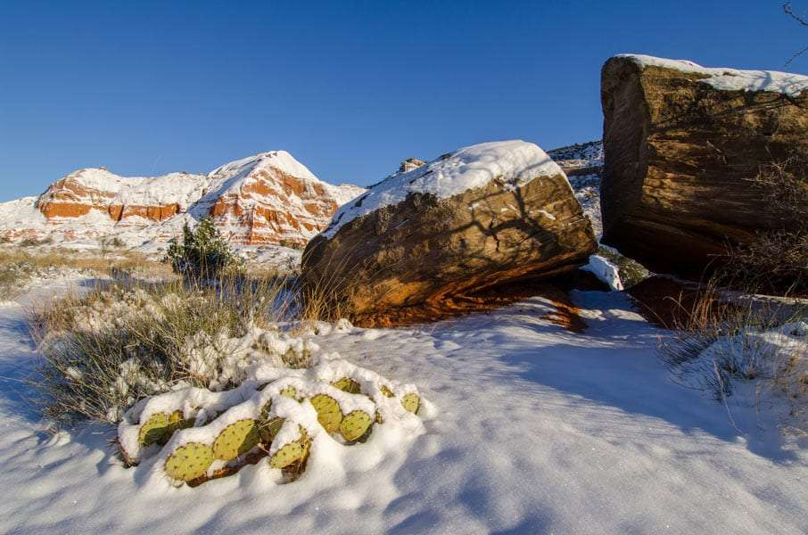 snow over the rocks and desert of Palo Duro Canyon State Park