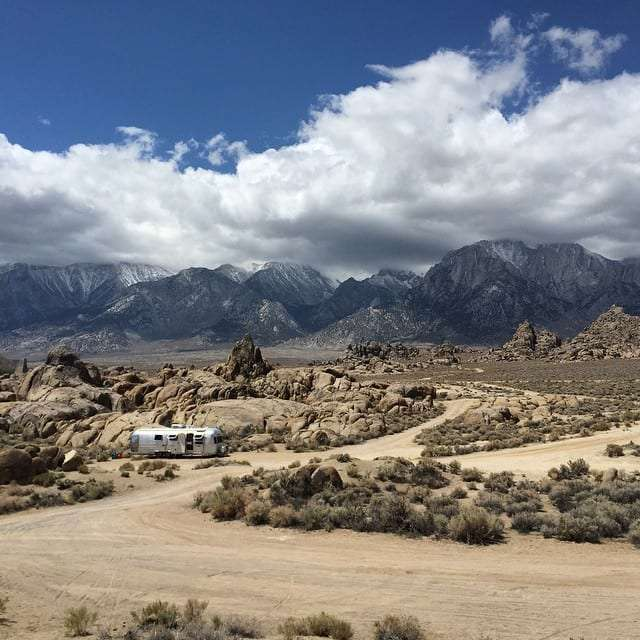 a vintage airstream dry camping in the california desert near the Sierra Nevada mountain range