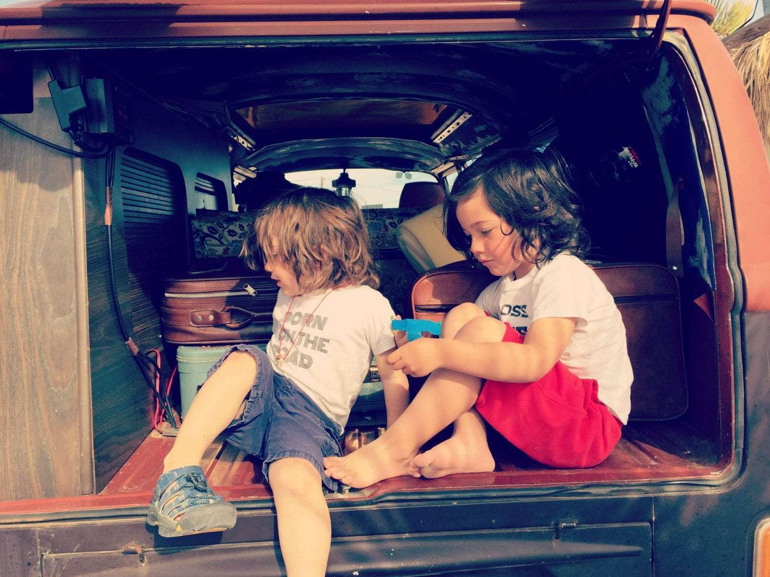 Scenes from a VW Bus: Brothers learn to play nicely on the back porch.