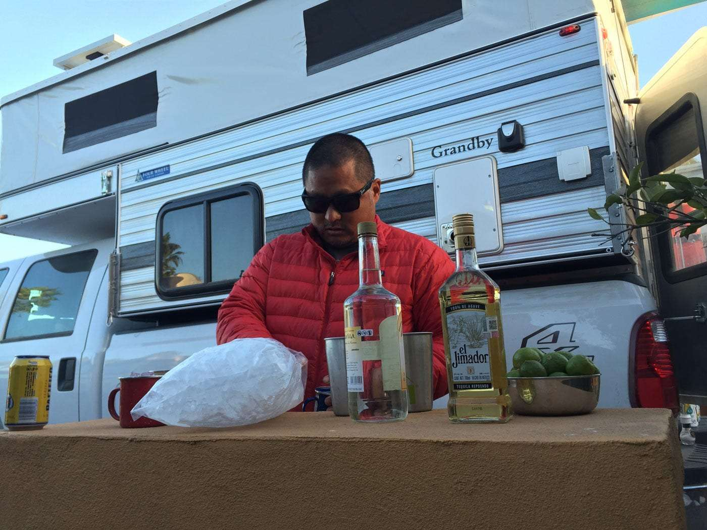 a man making margaritas outside of his truck camper