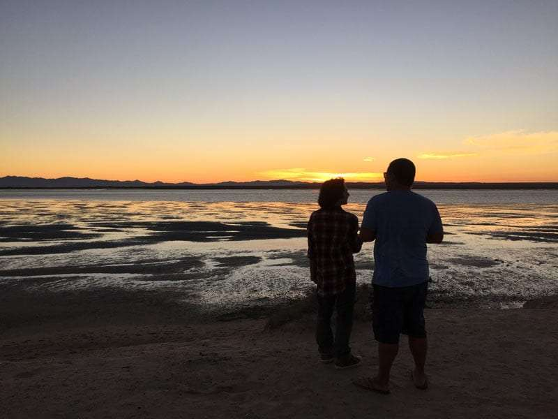 a man and a teenager looking over the bay