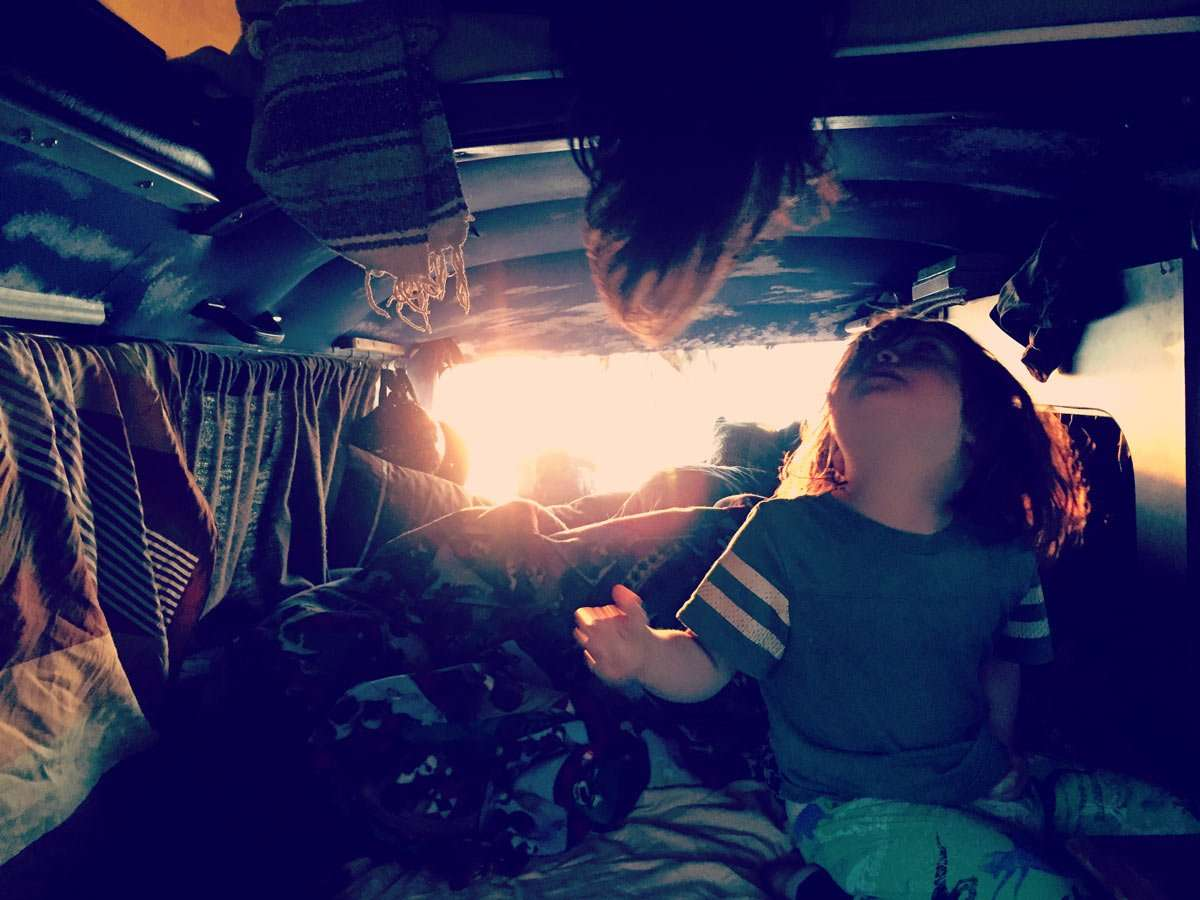 the boys stirring early in our 1978 Champagne Edition VW Bus