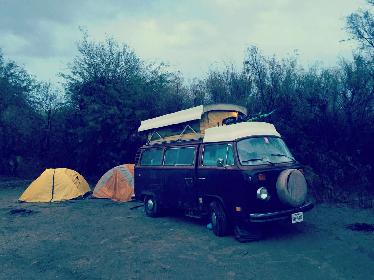 a Volkswagen Bus and two tents