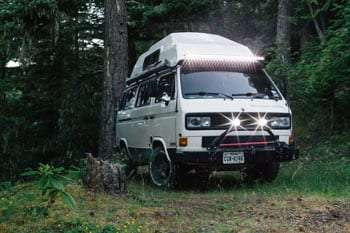 lights shine from a vanagon (in the rain?)
