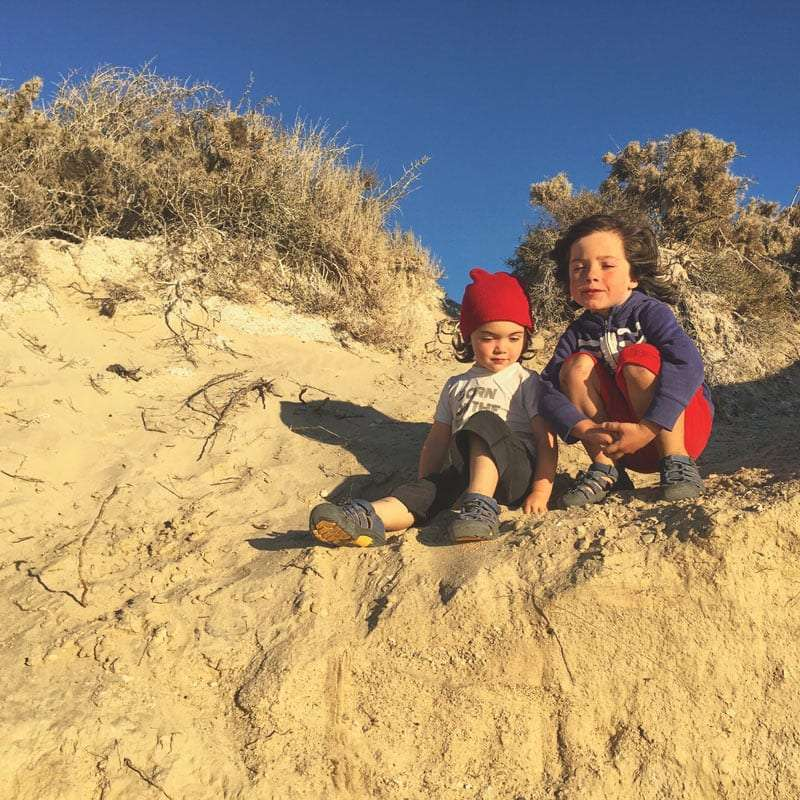 my two young boys on a sand dune