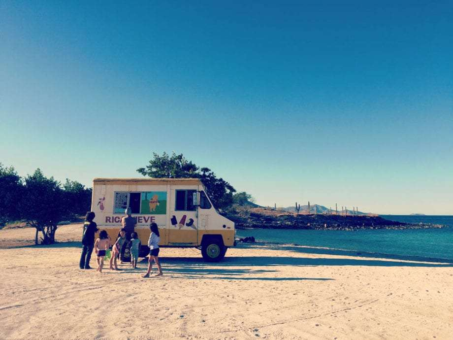 An ice cream truck, quite out of place, appears at La Perla, a beach camping spot on Bahia de Concepcion.
