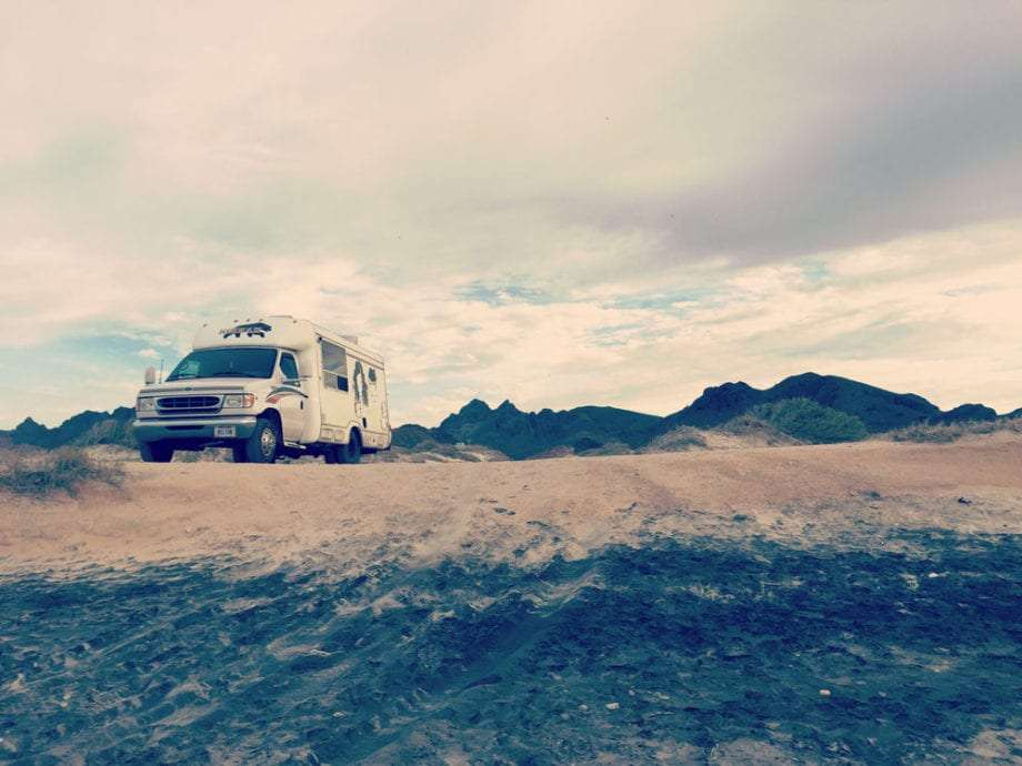an rv parked on the beach