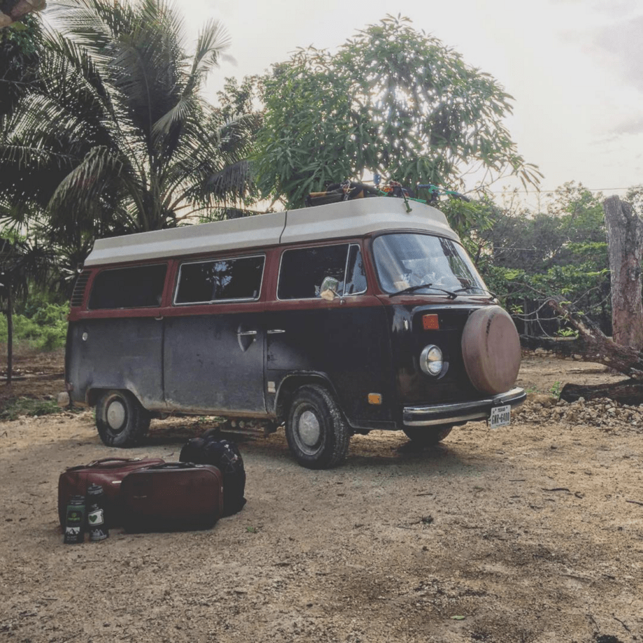suitcases sit outside of a vw bus