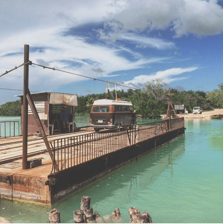 a VW Bus on a handcranked ferry in Belize