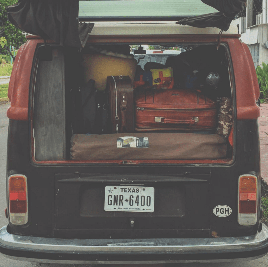 suitcases in the back of a vw bus
