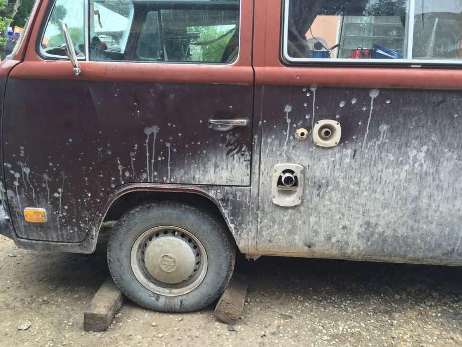 a dirty, rusty VW bus