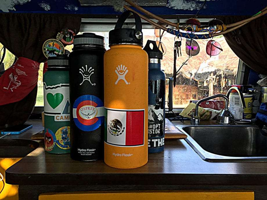 four hydroflasks in a volkswagen bus