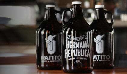 three growlers of cerveza artesanal