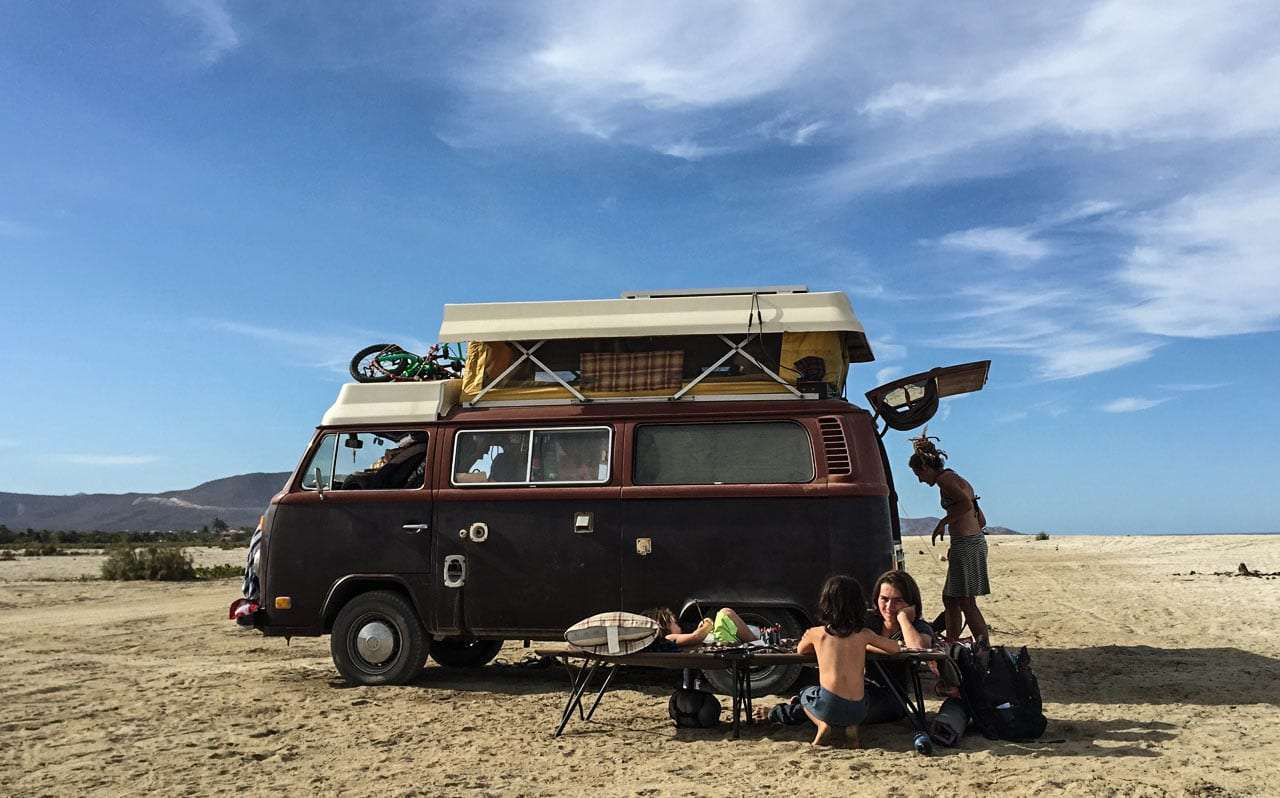 a family living out of a 1978 Volkswagen Bus