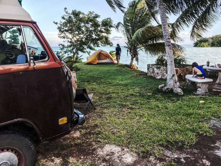 a volkswagen bus and tent camped outside of chetumal at calderitas, quintana roo, mexico