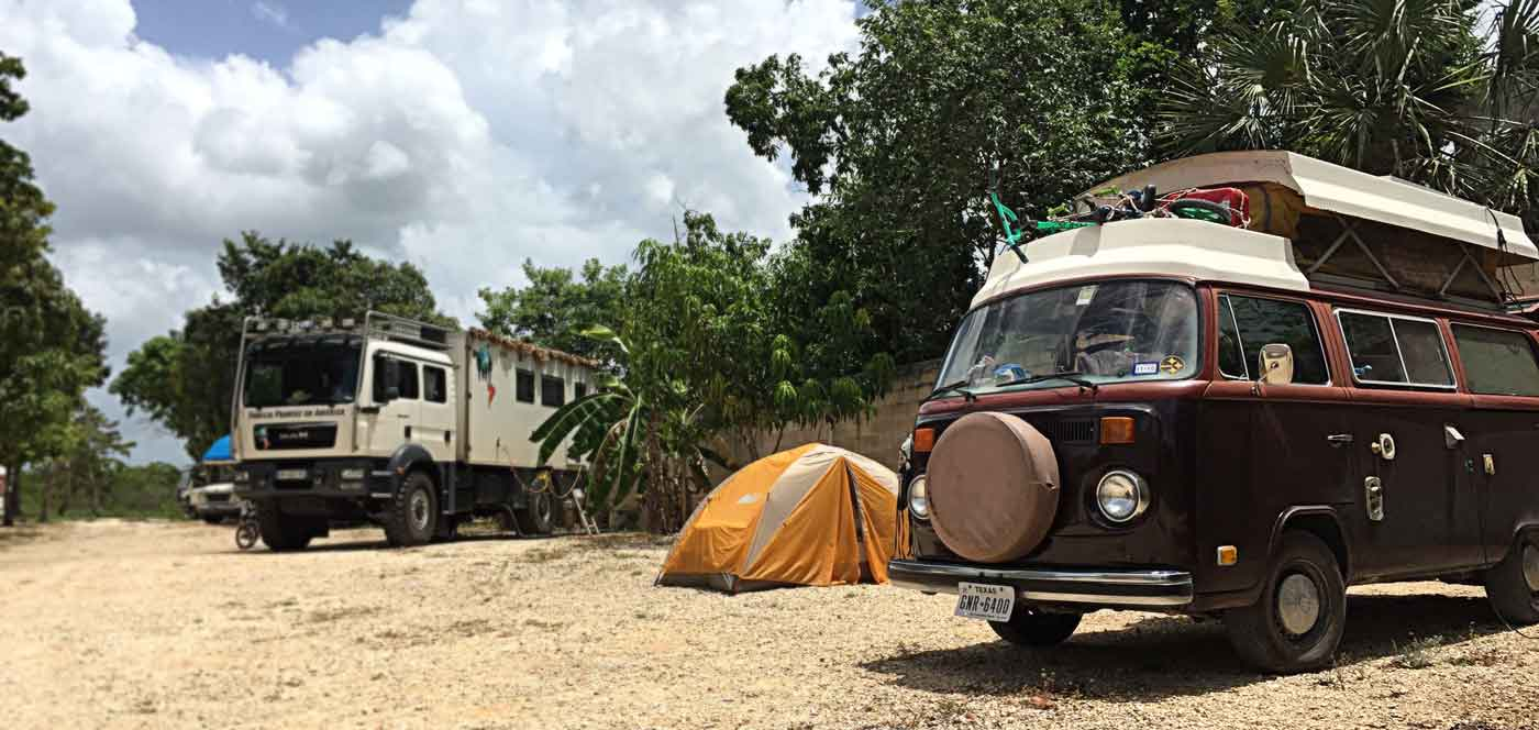 an rv, a tent and a vw bus at a campground in Cancun quintana roo