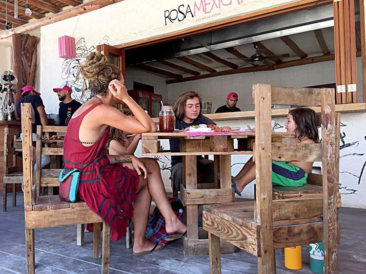a family eats mexican breakfast on isla holbox