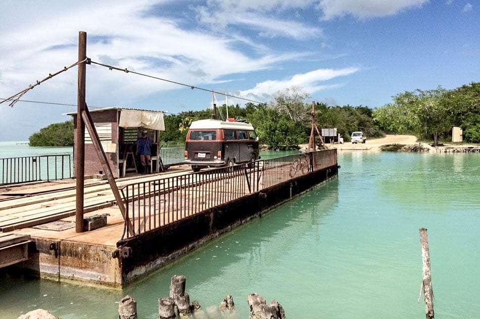 Volkswagen Bus crossing river via ferry near Corozal Town, Belize