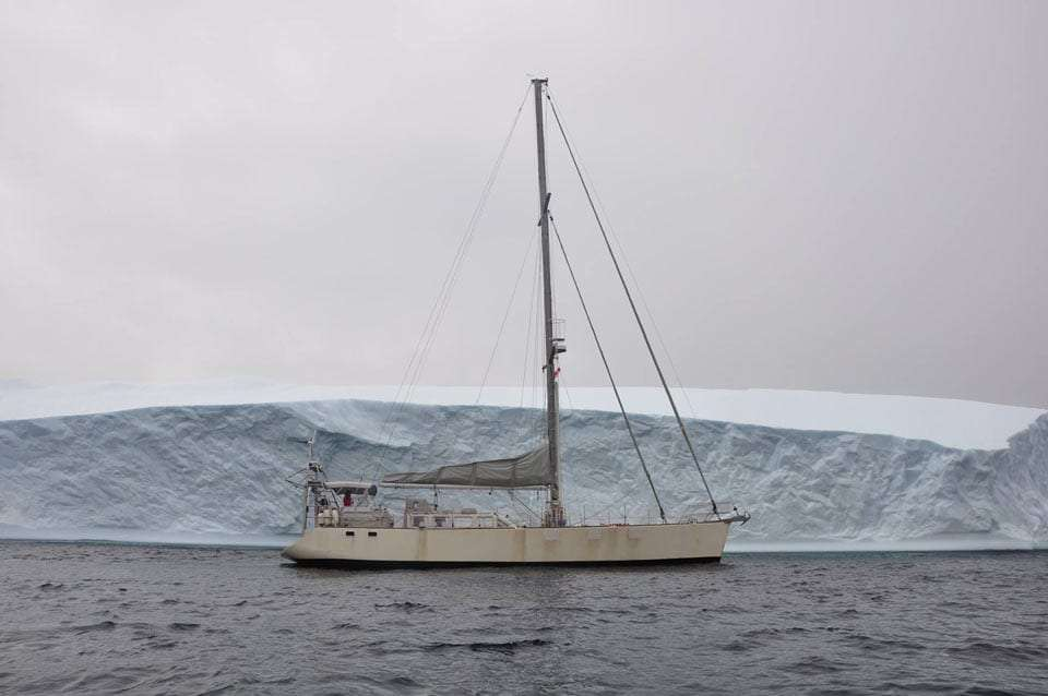 a boat near an ice shelf