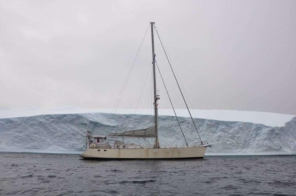a boat near an ice shelf