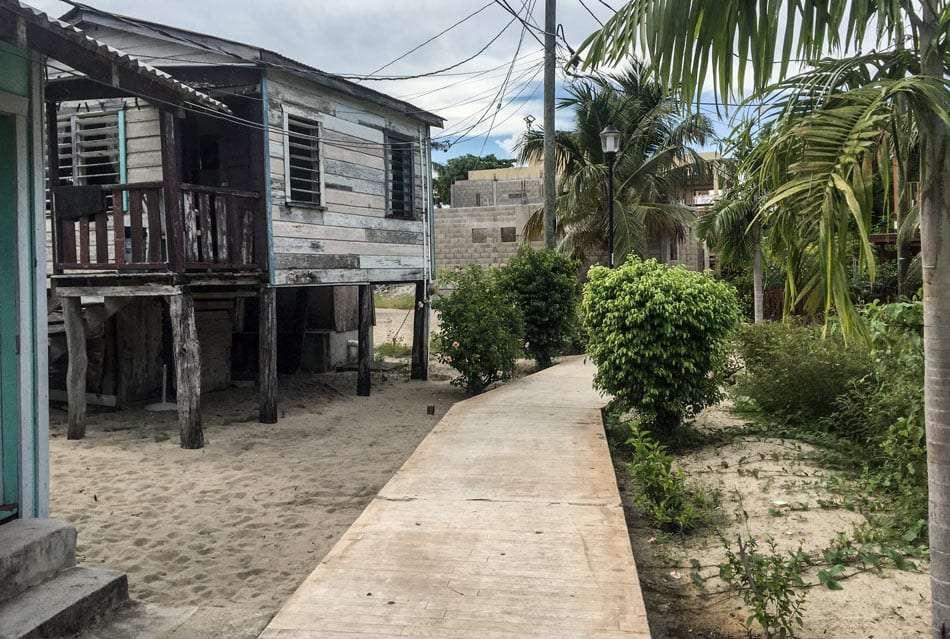rough looking buildings along a sidewalk