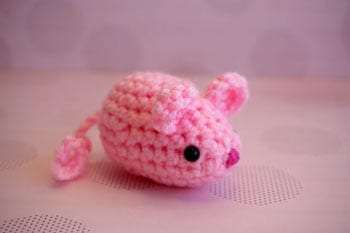 a cute crocheted pink mouse, available on Rachel's Etsy store