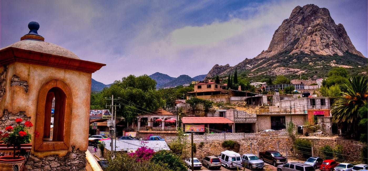 a town on a rolling hill in Mexico